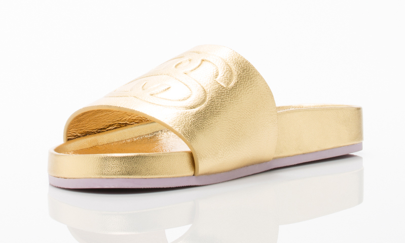 Stussy X Solestruck Link Slide Sandals in Gold_1