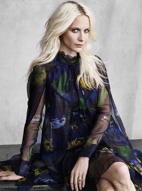 Poppy wears cape and dress by Erdem