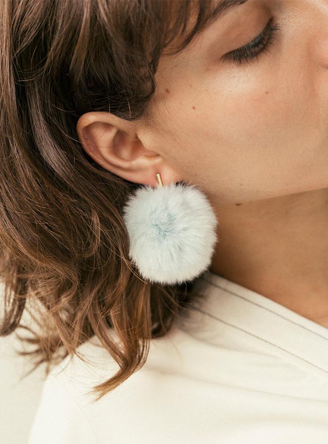 Tuleste 2%22 Pom Pom Earrings in Blue