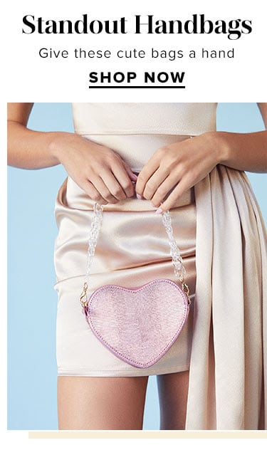 Statement Handbags. Give these cute bags a hand. SHOP NOW