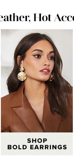 Shop bold earrings.